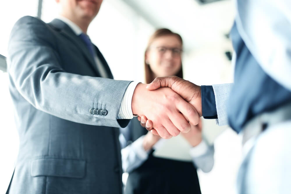 close up of two people shaking hands represent that trust is important in any business consulting relationship