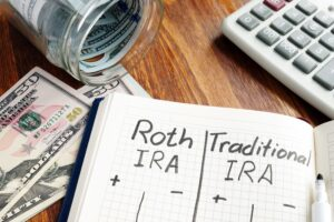 notebook showing pros and cons of a roth conversion from a traditional ira