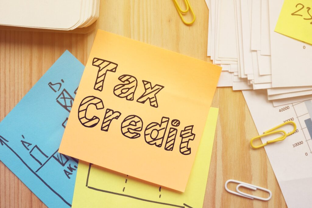 Post It Note that reads Tax Credit as graphic for article on Child Tax Credit