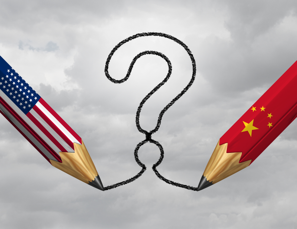 picture of two pencils, one with american flag and one with chinese flag drawing question mark about Biden Administration's China Policy